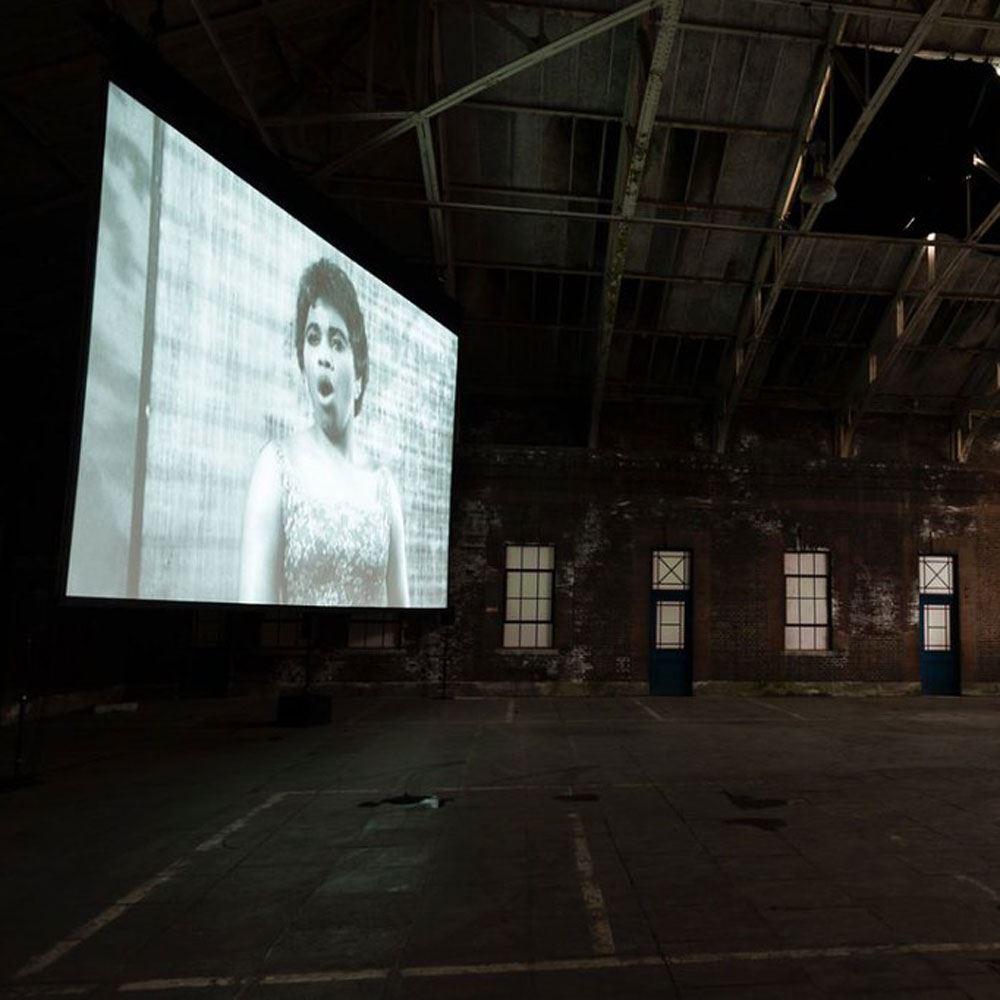 Artist film on show in warehouse