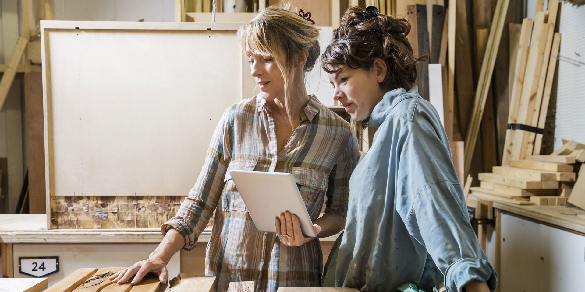 Two female carpenters planning